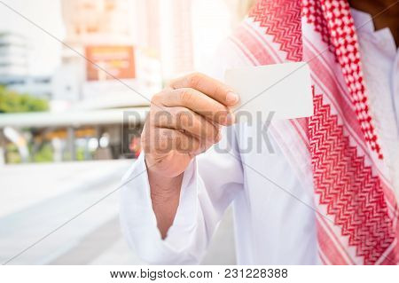 Arab Saudi Emirates Businessman Holding Business Card