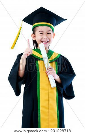 Kindergarten Graduation. Asian Child In Graduation Gown Holding Diploma Certificate And Showing Fore