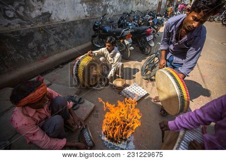 VARANASI, INDIA - MAR 14, 2018: Musicians on one of the city streets. Varanasi is one of the most important pilgrimage sites in India and is one of the 7 sacred cities of Hinduism.