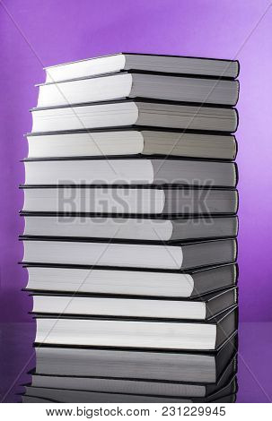 Stack Of Books On A Purple Background