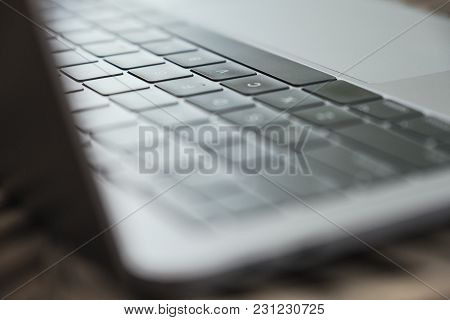 Closeup Image Of A Laptop Keyboard With Blur Background