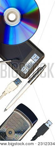 Mobile office: pda, phone, pen, CD and usb cables isolated on white