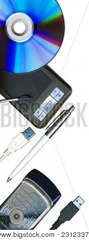 Mobile office: pda, phone, pen, CD and usb cables isolated on white, with clipping path
