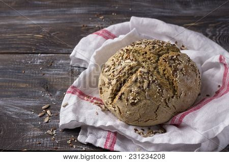 Simple Rustic Rye Oat Bread Without Yeast With Seeds On A Wooden Table, Selective Focus, Free Space