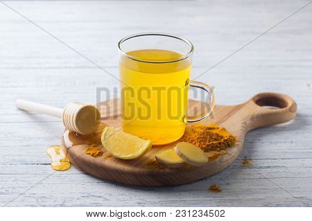 Energy Tonic Drink With Turmeric, Ginger, Lemon And Honey On A Wooden Board, Selective Focus
