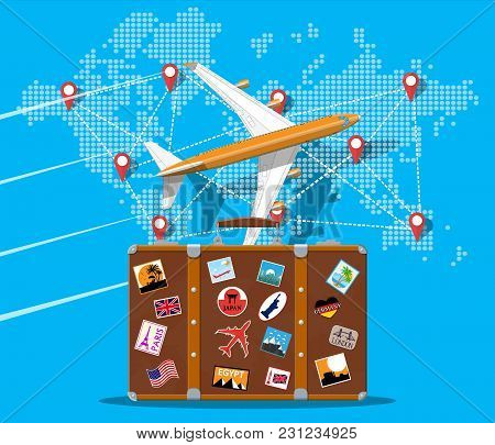 Travel Suitcase With Stickers Of Countrys And Citys All Over The World. World Map With Travel Destin