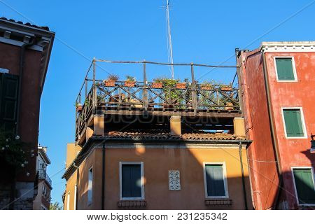 Picturesque Houses With Flowers On Terrace. Venice, Italy