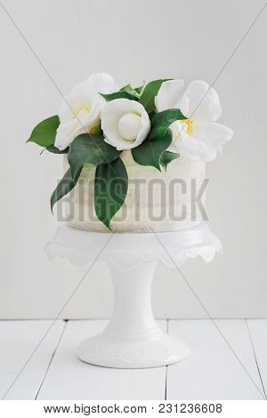 Naked Buttercream Layer Wedding Cake Decorated With Camellias