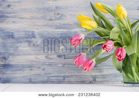 Half Spring Fresh Tulips Yellow And Red Bouquet On Rustic Shabby Blue Wooden Background With Copy Sp