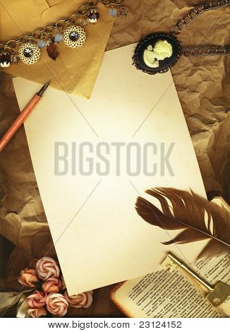 Vintage background with blank letter, flowers, a key and a bible