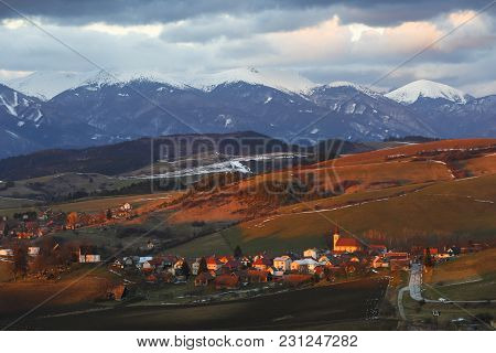 Village In Turiec Region With View Of Mala Fatra Mountain Range In Winter.