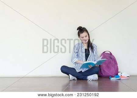 Student Teenage Reading Book Study,learning At University Campus Indoor Sitting And Smile Relaxing,