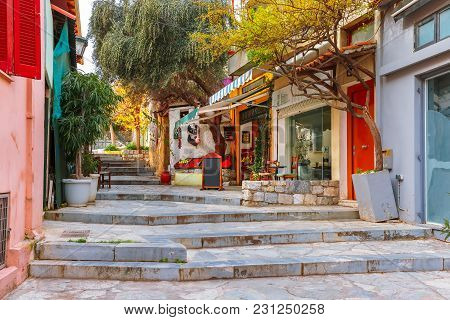 Beautiful Cosy Narrow Street With Stairs In Famous Placa District, Old Town Of Athens, Greece