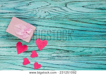 On A Dark Wooden Background There Are Hearts With A Gift Envelope. Valentine's Day Concept.