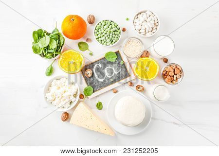 Healthy Food Concept. Set Of Food Rich In Calcium - Dairy And Vegan Ca Products, White Marble Backgr