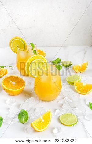 Vitamin Summer Refreshing Drinks. Citrus Punch With Oranges And Lime, With Mint Sprigs, Chilled With