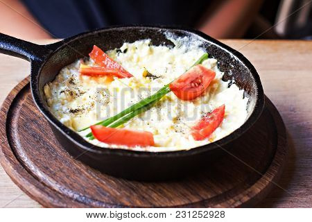 Omelette With Tomatoes In A Frying Pan. Omelette With Onion And Cheese In A Frying Pan.