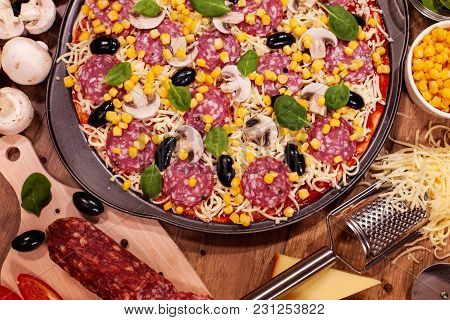 Fresh Homemade Pizza And Ingredients On A Table - Top View, Closeup