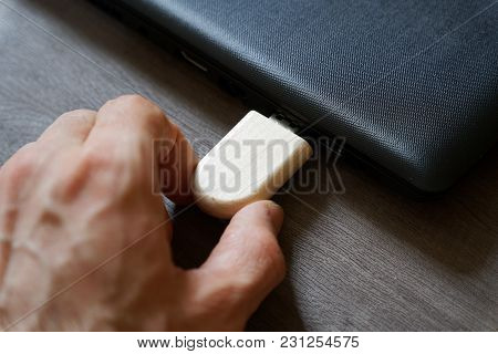 Hand Inserting Usb Flash Drive Connect To Usb Port Plug-in Computer Laptop For Transfer Data And Bac