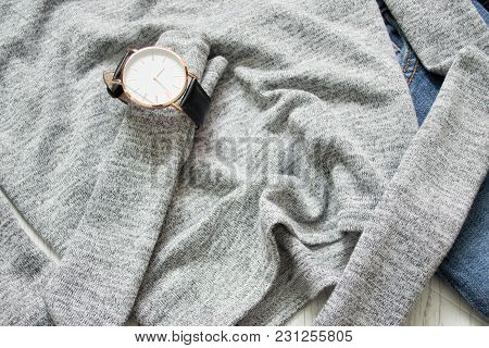 Watch On A Gray Sweater. Close-up. Details. Fashionable Concept