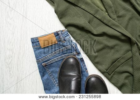 Blue Jeans, Boots And A Green Jacket. Details. Fashionable Concept