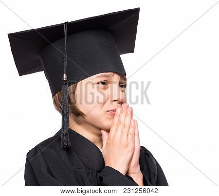 Portrait Of Graduate Little Girl Student In Black Graduation Gown With Hat, Close Up - Isolated On W