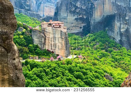 Panoramic View Of Meteora Monastery On The High Rock And Road In The Mountains At Spring Time, Greec