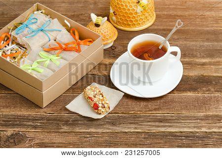 Tea Mug, Packing Of Bars And Sugar Bowl. Wooden Table