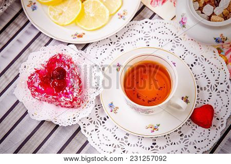 Steel-life With Porcelain Cup Of Tea, Lemon Slices And Sweets