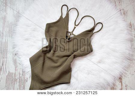 Khaki Body On White Fur. Fashionable Concept