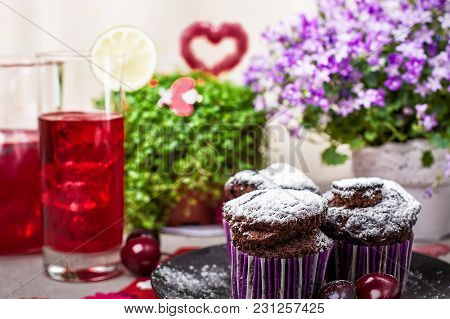 Chocolate Muffins And Lemonade With Decorations On The Table
