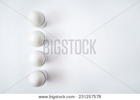 White Eggs Standing On Egg Cup Isolated On White Background, Copy Space. Row Of Boiled Eggs In Stand