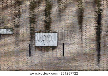 Horizontal Picture Of Bricky Wall Showing The Direction Of Vatican Museum In Vatican City, Italy