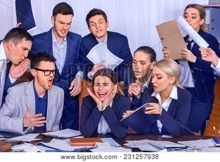 Business people office. Team people are unhappy with their leader. Intern manager does not cope with his duties. Crowd in stress. Top view. Firm has reduced revenues for year.
