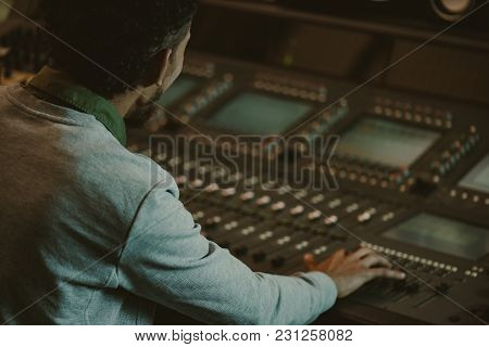 Close-up Shot Of Sound Producer Working With Analog Equalizer