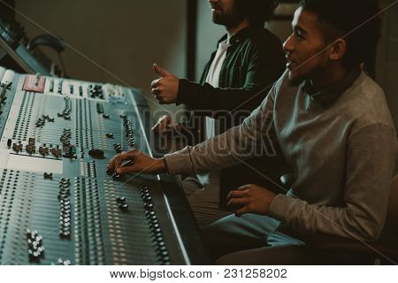 Handsome Young Sound Producers At Recording Studio