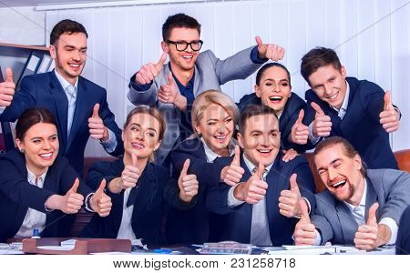 Business people office life of team people happy sitting table. People in business suits are happy from successful deal and wish success to everyone around them. Firm increased its revenues for year.