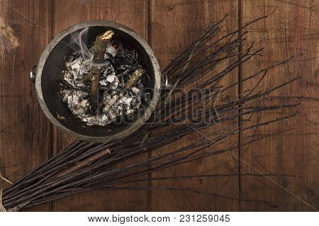 Overhead Photo Of Smoking Witch's Cauldron With Broom And Copy Space