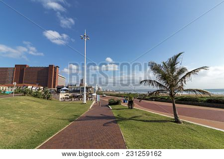 Beachfront Promenade Against Blue Coudy Cityscape In Durban