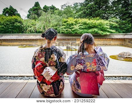 Kyoto, Japan - June 7: Unidentified Women Dress In Traditional Clothes And Observe Japanese Typical