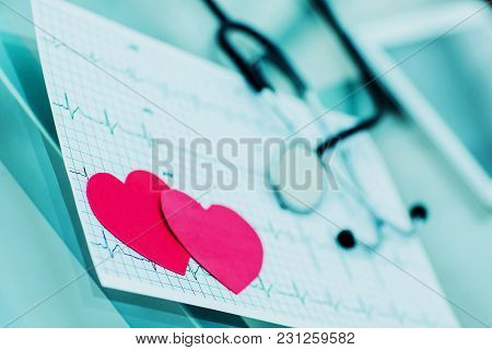Two Red Paper Heart On The Electrocardiogram, The Cardiologist.the Photo Is A Blank Space For Your T