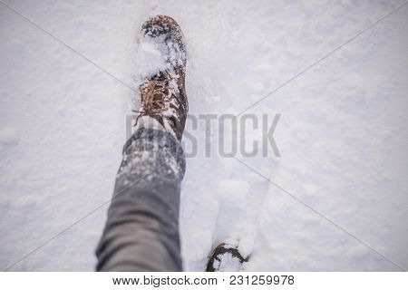 Photo Of Man's Feets In Boots In Snow