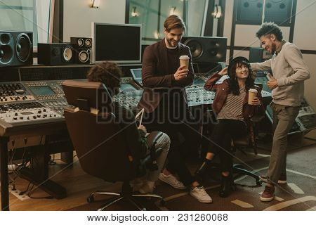 Sound Producers Spending Time At Recording Studio