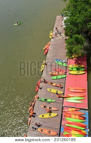 Colorful kayaks station - as seen from Key Bridge over Potomac River, Washington DC USA
