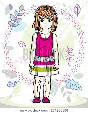 Cute Little Redhead Girl In Fashionable Casual Clothes Standing On Natural Spring Backdrop With Tree