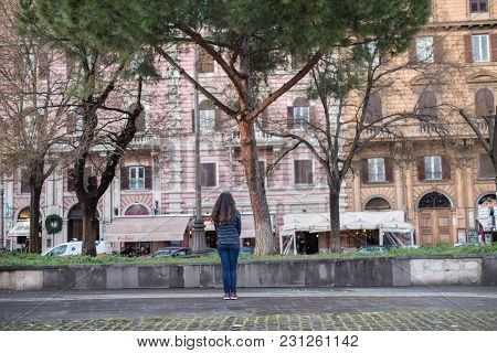 Vatican City, March 06, 2018: Horizontal Picture Of The Back Of Long Hair Woman Looking The Building