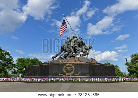 WASHINGTON DC - 25 MAY 2014: Iwo Jima Memorial in Washington DC, USA. The Memorial framed with flower bouquets during Memorial Day week.