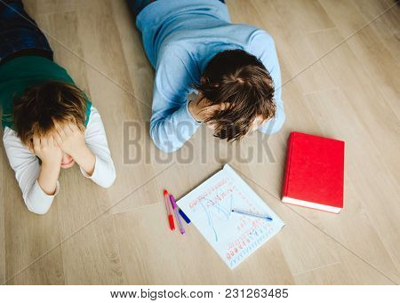 Father Stressed Tired Of Doing Homework With Son