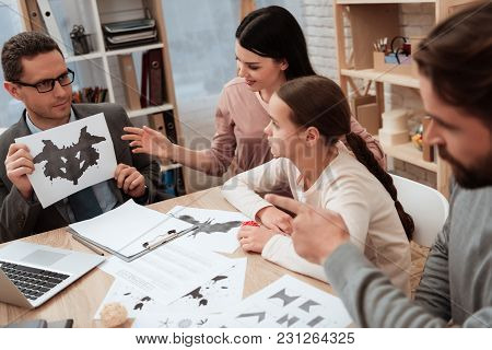 Bearded Adult Man With Family Pass Rorschach Test With Family Psychologist. Family At Reception With