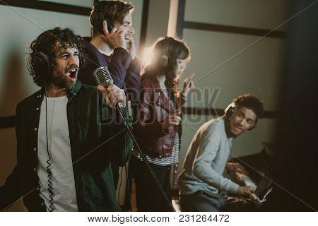 Music Band Recording Song At Studio While Man Playing Piano